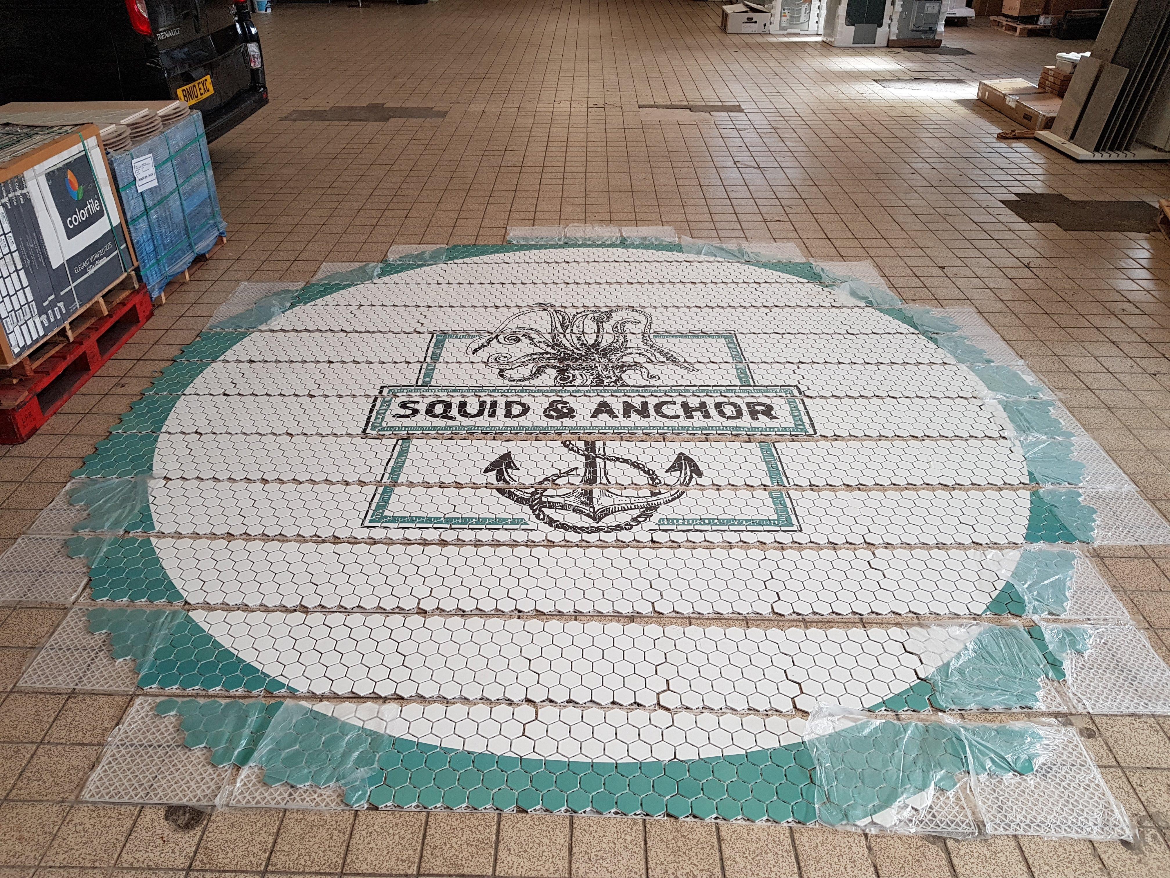 floor mosaic logo